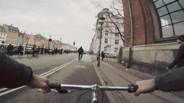 POV riding a urban road city bicycle in Copenhagen POV riding a urban road city bicycle handlebar stock videos & royalty-free footage