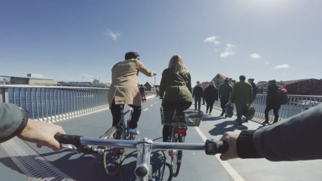 POV riding a urban road city bicycle with friends video