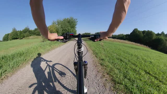 Riding Bicycle on Dirt Road on Sunny Day Wide Angle POV Riding Bicycle on Dirt Road on Sunny Day Wide Angle POV handlebar stock videos & royalty-free footage