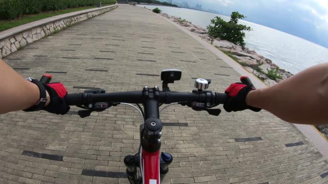 Riding Bike on Seaside Road Riding Bike on Seaside Road handlebar stock videos & royalty-free footage