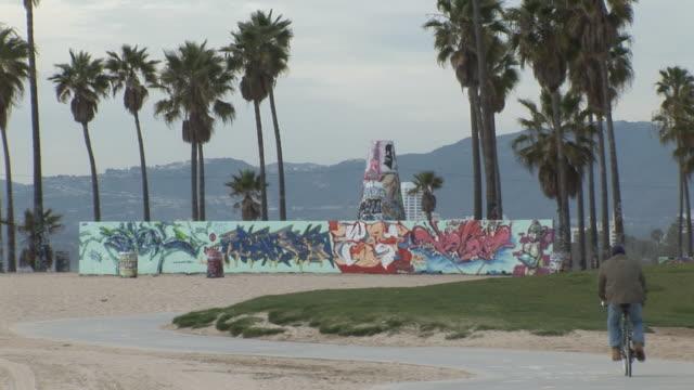 (HD1080i) Riding Bike Past Graffiti