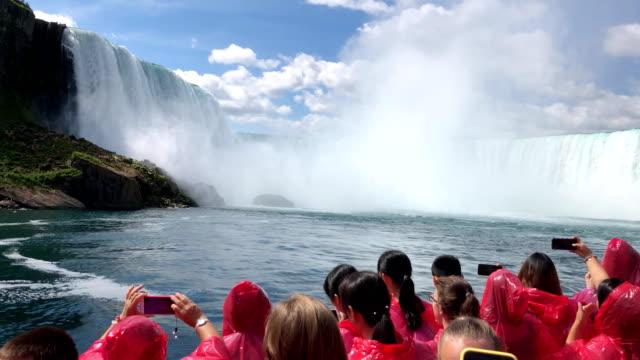 Riding boat up to Niagara Falls On Summer Vacation