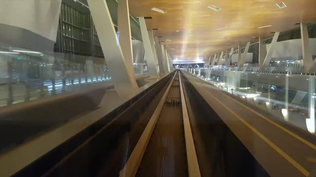 POV: Riding inside a modern train transporting passengers around Doha airport.