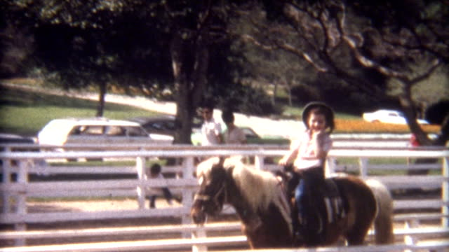Riding Pony 1960's A young girl rides a pony in the 1960's. horseback riding stock videos & royalty-free footage