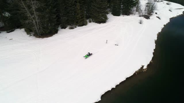 Riding Snowmobile Fast by Sno Park Lake video