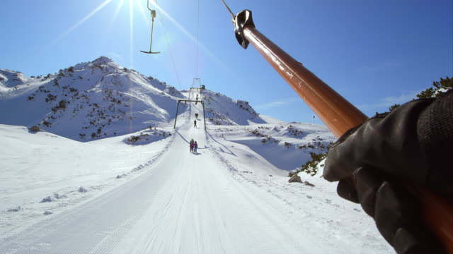 POV Riding the double hanger surface ski lift up slope video