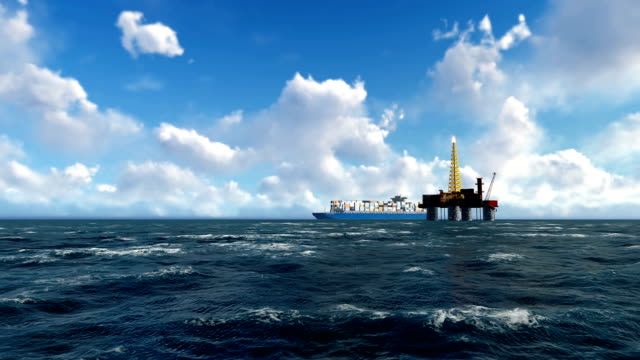 vídeos de stock e filmes b-roll de rig oil at sea and container ship navigating - noruega
