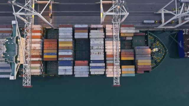 AERIAL Right above a large cargo ship full of shipping containers