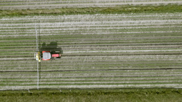 AERIAL Right above a tractor spraying the crops video