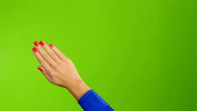 Right hand is widely waving goodbye or hello. Green screen video