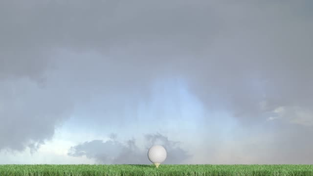 Right to left straight move of a golf ball on a well cutted green with a cloudy sky