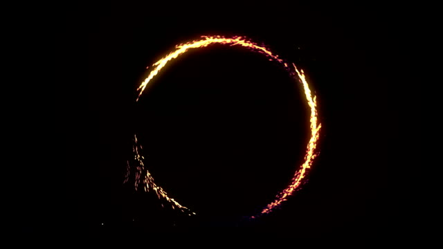 ring of fire and sparks spinning fast on a black background - circus стоковые видео и кадры b-roll