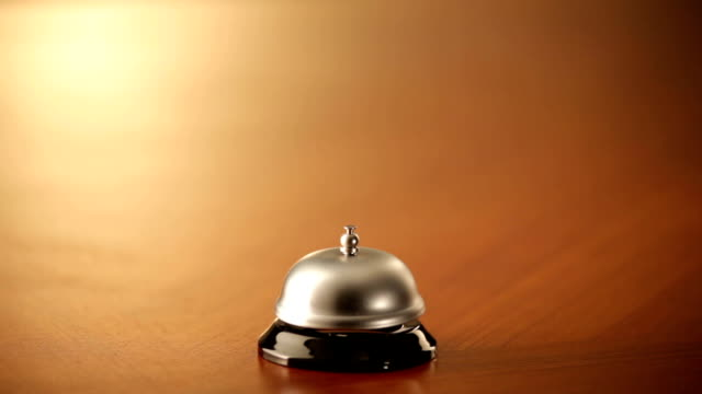 ringing a service bell with fist video