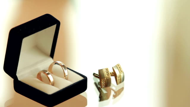 rings in the box and cufflinks are on a glass table video