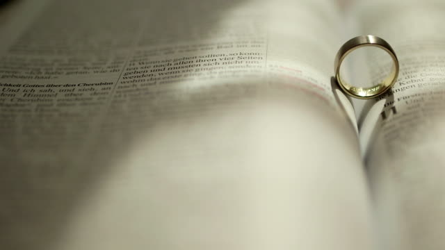 Rings on the Bible - Stock Footage video