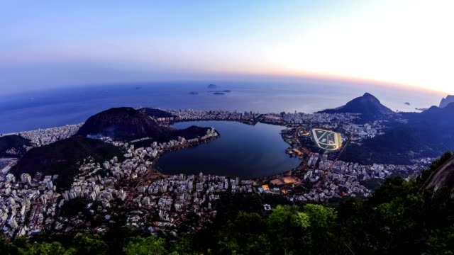 Rio Cityscape Time Lapse Dusk Zoom v7. Rio De Janeiro zooming cityscape time lapse after sunset. cristo redentor stock videos & royalty-free footage