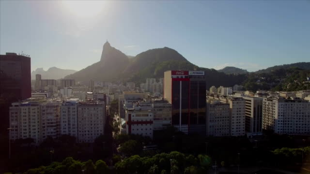 Rio de Janeiro Aerial: sideways move across Botafogo beach with Christ the Redeemer in the background and high rise buildings in the foreground video