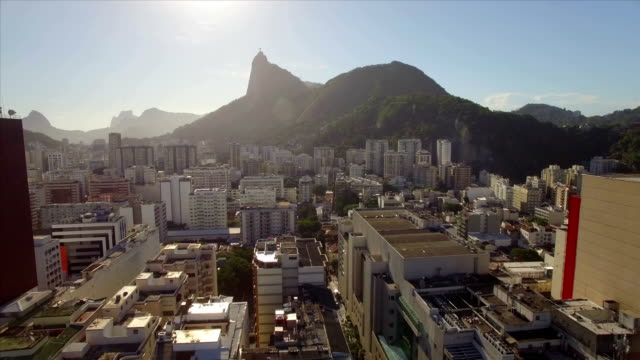 Rio de Janeiro Aerial: sideways move across Botafogo beach with Christ the Redeemer in the background and high rise buildings in the close foreground video