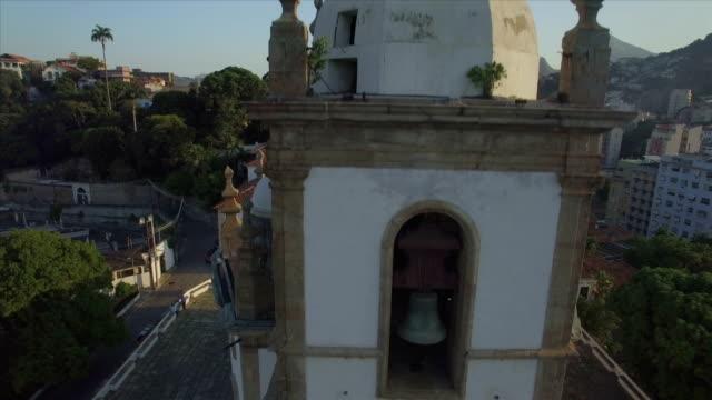 Rio de Janeiro Aerials: close upwards move past the bell tower, turrets and steeple of Nossa Senhora da Gloria Church video
