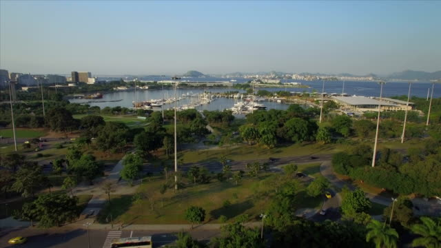 Rio de Janeiro Aerials: move towards boats in the Gloria Marina and Flamengo Urban Park with Guanabara Bay in the background video