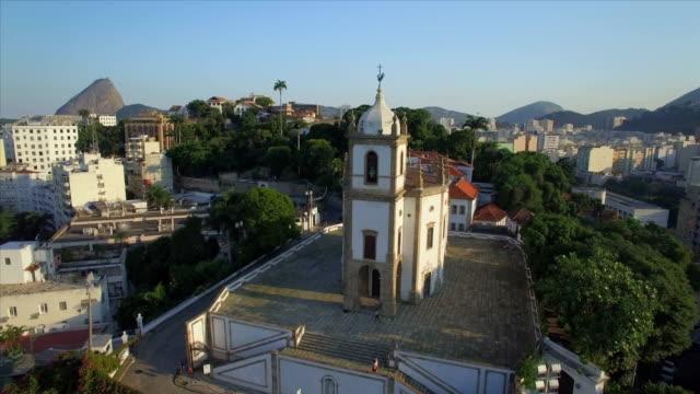 Rio de Janeiro Aerials: Slow move towards hilltop Nossa Senhora da Gloria church at sunset video