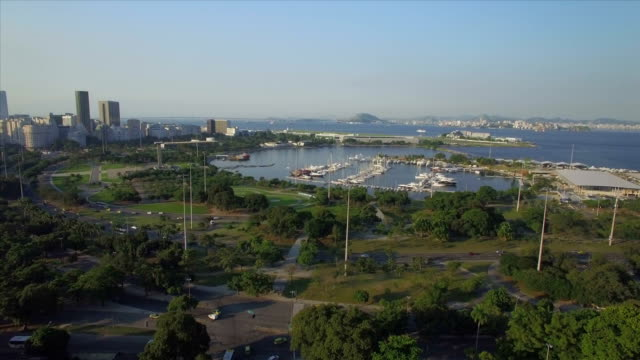 Rio de Janeiro Aerials: traffic circulating by the Gloria Marina and Flamengo Urban Park with Guanabara Bay in the background video