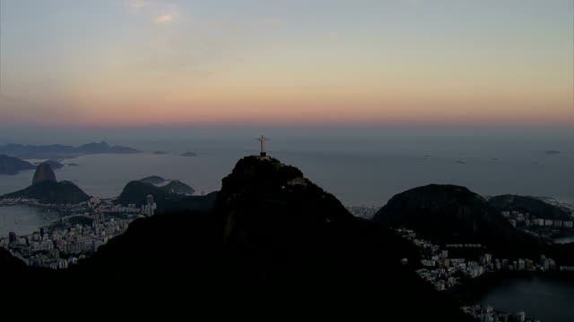 Rio de Janeiro, Brazil at dusk, aerial shot HD 1080P:  Rio de Janeiro, Brazil at dusk, aerial shot.  Shot with cineflex gyro-stabilized camera system. cristo redentor stock videos & royalty-free footage