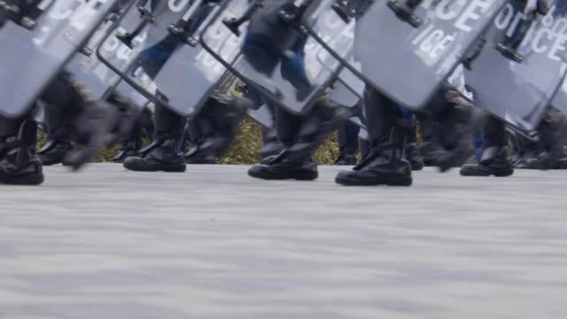 riot police protecting the city - ribellione video stock e b–roll