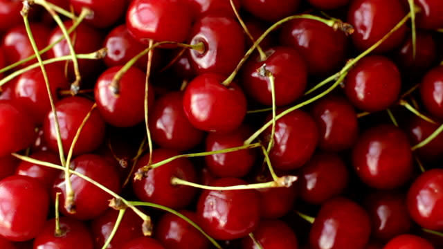 Ripe cherry fruits full frame, top view Ripe cherry fruits full frame, top view cherry stock videos & royalty-free footage