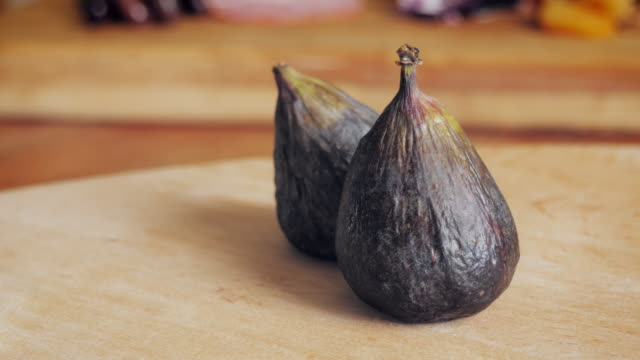 Ripe Figs on a Wooden Cutting Board - 4k video
