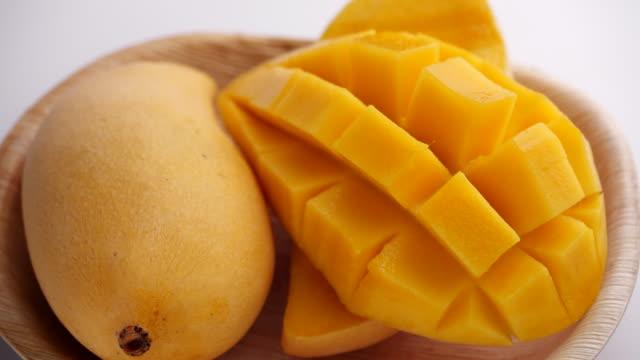 Ripe Slide of mangoes. Organic summer tropical fruit, Ripe Sliced Mango Squared rotation in 4k slow motion Ripe Slide of mangoes. Organic summer tropical fruit, Ripe Sliced Mango Squared rotation in 4k slow motion mango stock videos & royalty-free footage