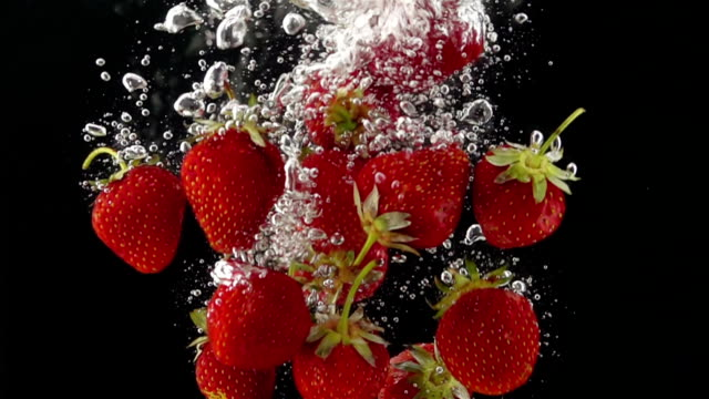 Ripe Strawberries Falling through the Water video