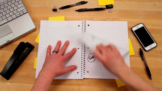 Ripping, crumpling and tossing paper from notebook, top view video