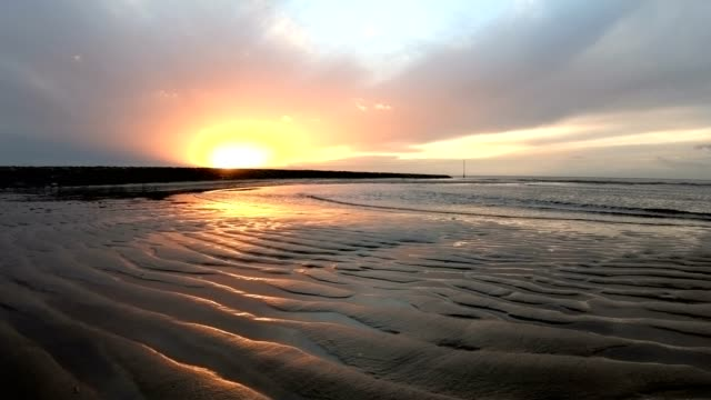 ripple mark by the wadden sea at sunset, low tide, north sea - илистая пойма стоковые видео и кадры b-roll