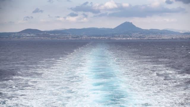 rippled sea against mountain, santorini, greece - isole egee video stock e b–roll