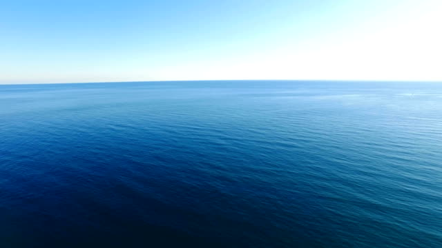 AERIAL: Rippled surface with transparent water Calm sea with clear horizon in early morning, aerial video sea stock videos & royalty-free footage
