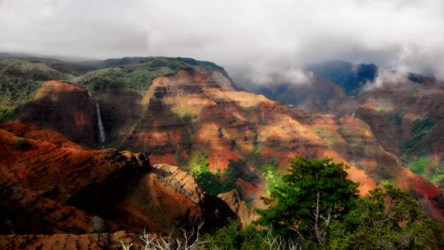 Rise over Waimea Canyon on the island of Kauaii, Hawaii The photogenic views of the colorful and beautiful Waimea Canyon State Park on the island of Kauai, Hawaii. oceania stock videos & royalty-free footage