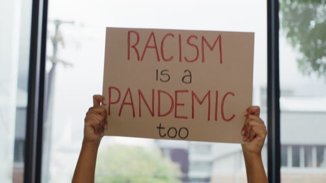 Rise up against racism 4k video footage of an unrecognisable woman protesting against racism indoors civil rights stock videos & royalty-free footage