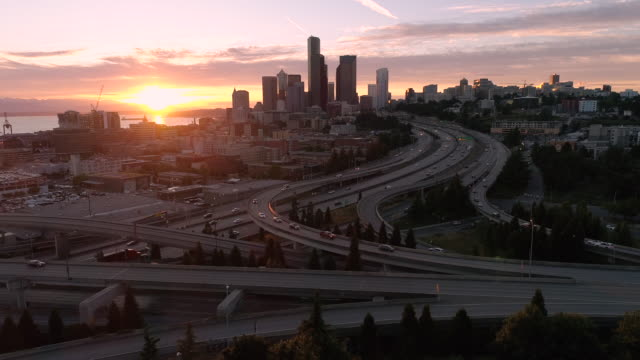 Rising Aerial of Golden Hour Sunset on Downtown Cityscape in Pacific Northwest video