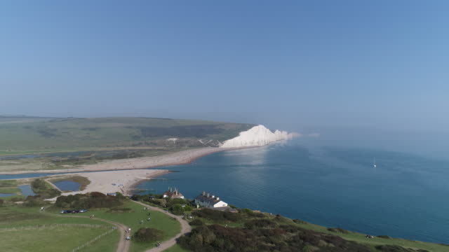 rising aerial view of cuckmere haven and white cliffs of birling gap - south downs video stock e b–roll