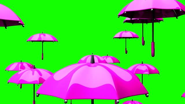 vídeos de stock e filmes b-roll de rising pink umbrellas on green chroma key - guarda chuva