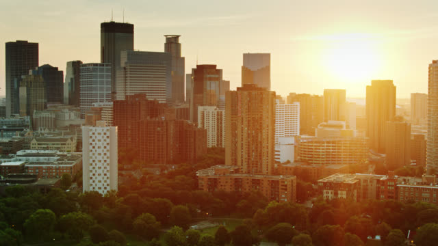Rising Sun Shining Between Apartment Buildings and Office Towers in Minneapolis, Minnesota video