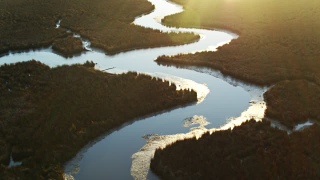 Rising Sun Shining on Water of Pascagoula River Delta, Mississippi video