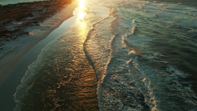 Rising Sunlight on Gentle Waves - Drone Shot