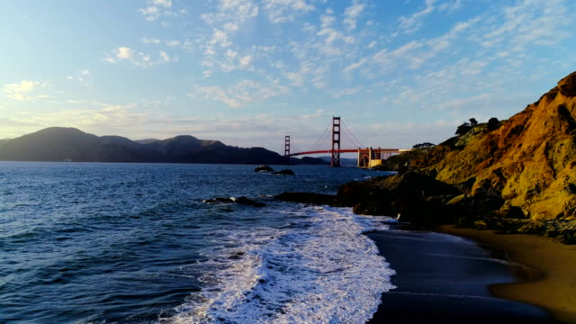 Rising up over Baker's Beach in San Francisco , California View of Golden Gate Bridge at Sunset
