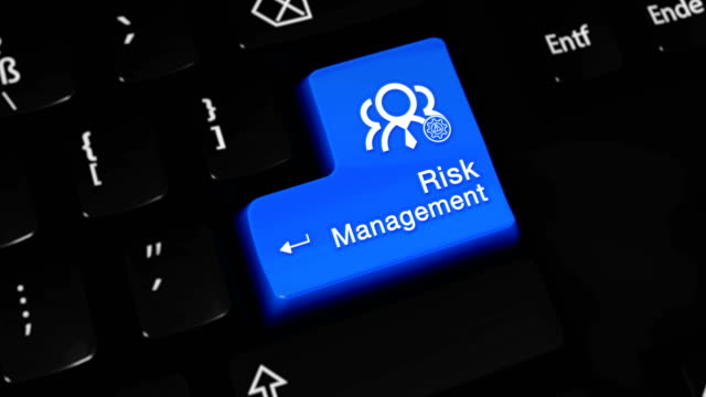 risk management moving motion on blue enter button on modern computer keyboard with text and icon labeled. selected focus key is pressing animation. business management concept - rischio video stock e b–roll