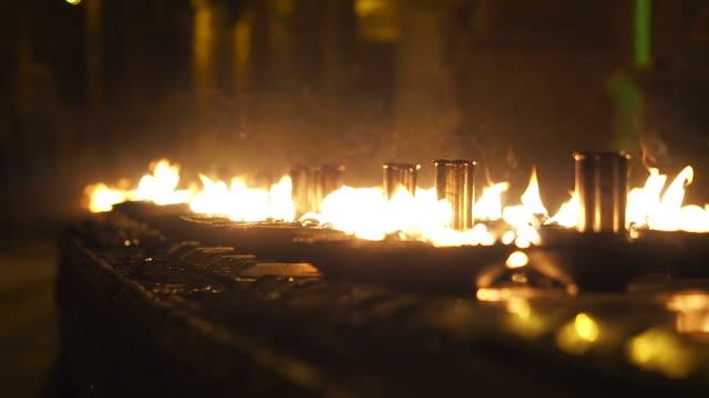Ritual candles in Shwedagon Pagoda video