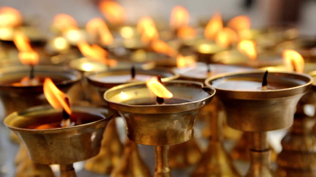 Ritual candles nearby Boudha stupa in the Nepal. video