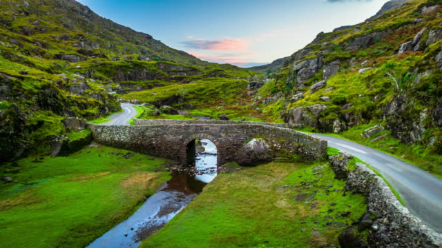river and stone bridge at the gap of dunloe in ireland - rivulet 4k stock videos and b-roll footage