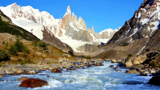 River below mountain peaks of Cerro Torre, Patagonia, Argentina video